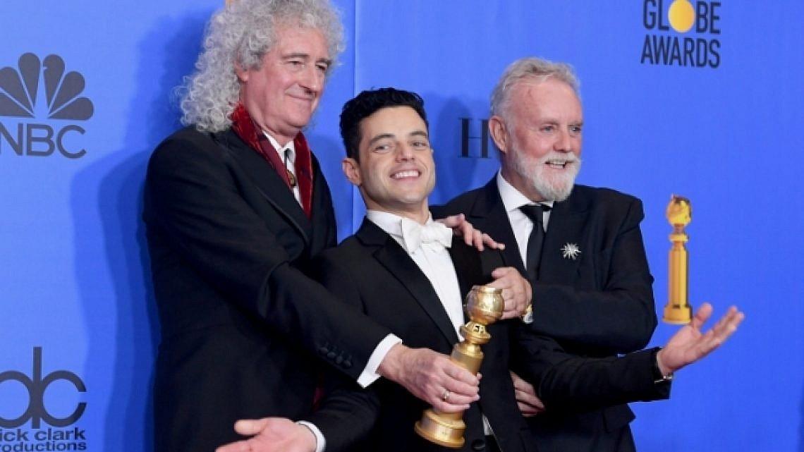 ראמי מאלק בין חברי קווין, בריאן מיי ורוג'ר טיילור, בטקס גלובוס הזהב אמש (צילום: Getty Images)