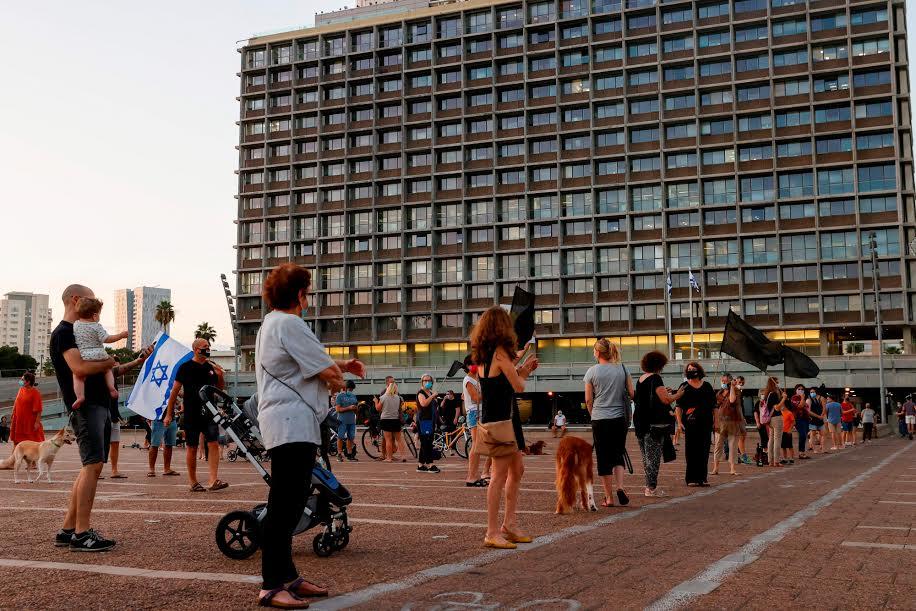 """למה לא אמרתם שהכי טוב קל""""ב. """"מחאת הקילומטר"""" במוצ""""ש בכיכר רבין (צילום: ג'ק גואז\גטי אימג'ס)"""