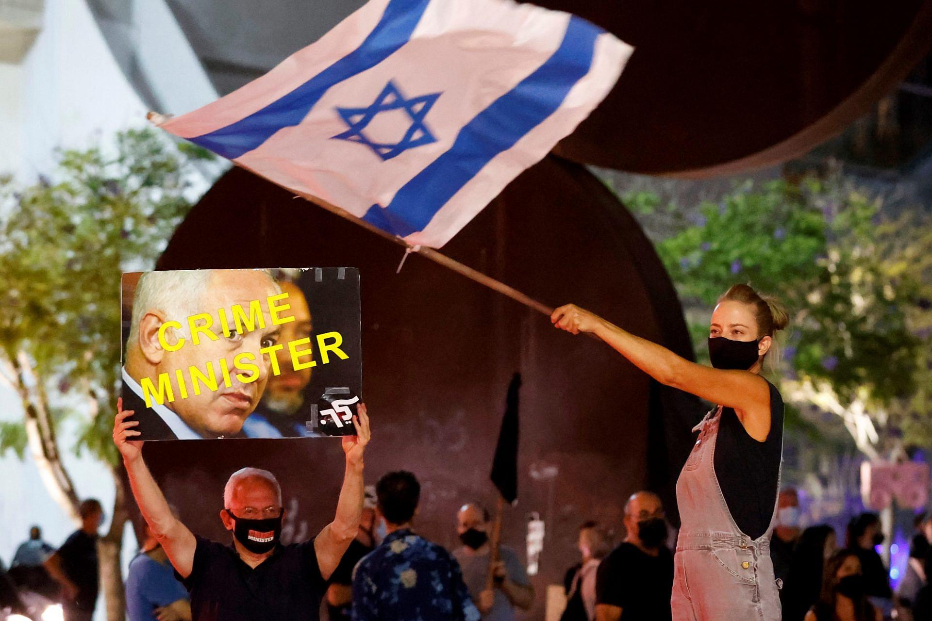 """תודה ביבי, הוצאת אותנו מהבית. מפגינים בכיכר הבימה, מוצ""""ש (צילום: ג'ק גואז\גטי אימג'ס)"""