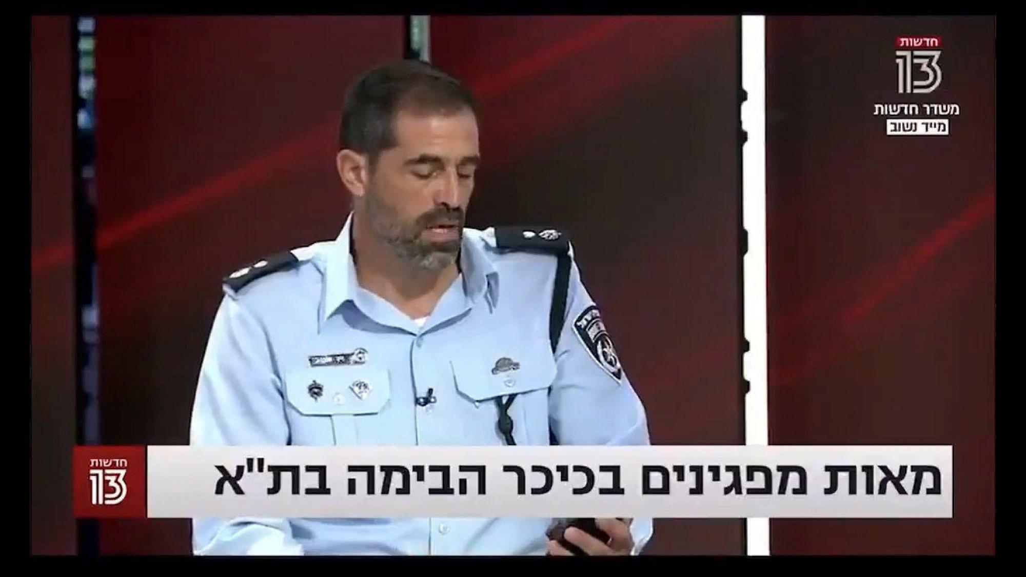 """מפיצים את נגיף הפייק ניוז. סנ""""צ זיו שגיב והווטסאפ שלו בחדשות 13 (צילום מסך)"""
