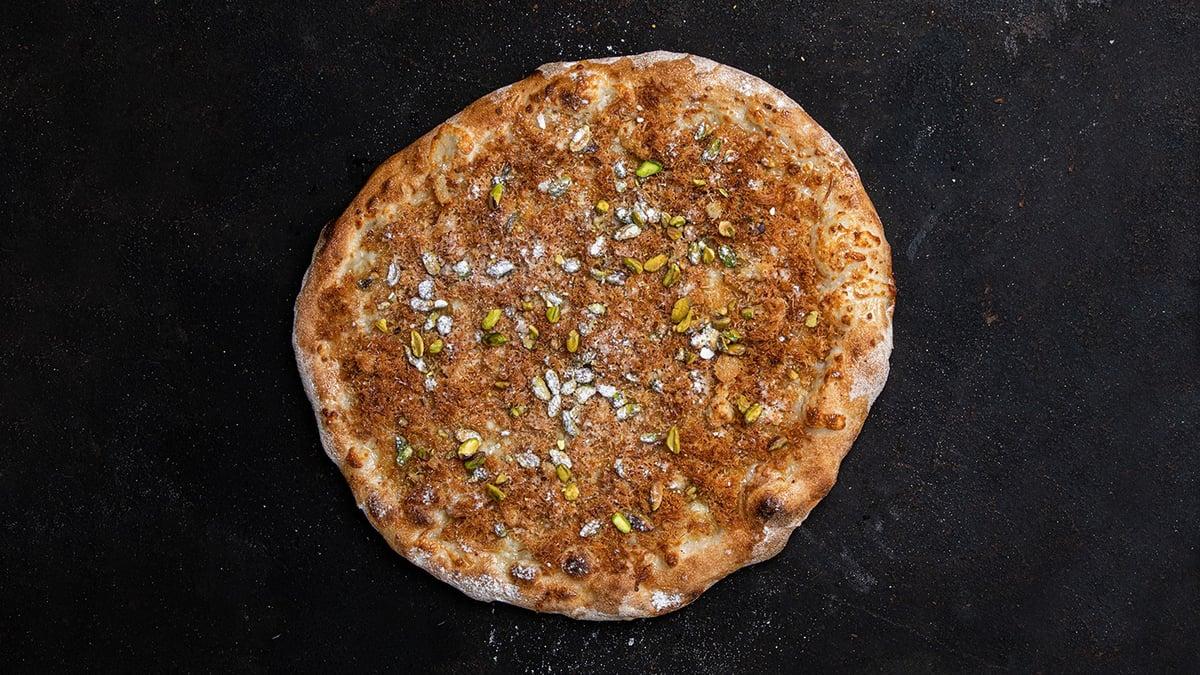 פיצה כנאפה של ארז קומרובסקי (צילום: איתן וקסמן)